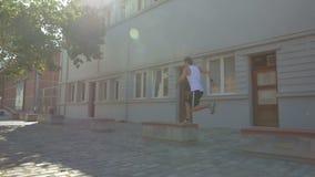 Free runner performing in city street stock video