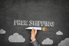 Free shipping concept on blackboard Stock Image