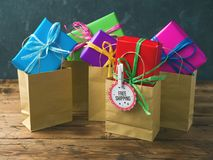 Free shipping concept. With shopping paper bag and gift boxes stock photos