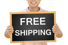 Free shipping sign on blackboard Royalty Free Stock Images