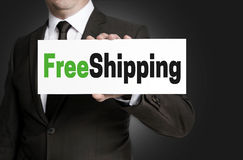 Free shipping sign is held by businessman Royalty Free Stock Photo