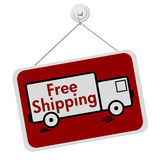Free Shipping Sign. That is red and hanging with a truck on it royalty free stock image
