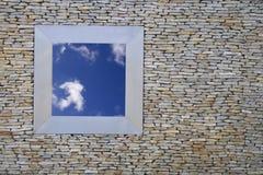 Free Sky. An open window showing a beautiful cloudy sky Stock Image