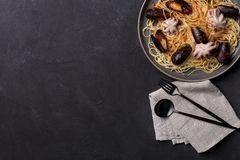 Free space corner pasta with seafood on dark background royalty free stock photos