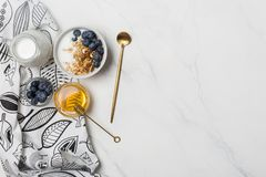 Free space granola breakfast with honey and berries stock photo