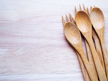Directly above shot of wooden cutlery, spoon and fork on cutting board. stock photos