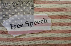 Free Speech, Constitution and flag. Free Speech news headline on a copy of the  United States Constitution and the US flag Royalty Free Stock Photography