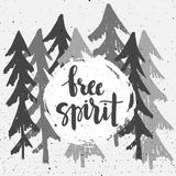 Free Spirit hand-written phrase. On forest background in black and white colors. Hand drawn lettering. Modern brush calligraphy Royalty Free Stock Images