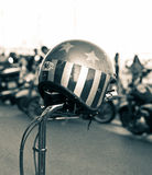 Free Spirit. Open faced helmet on a motorcycle`s handlebars Stock Image