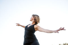 Free Spirit Woman. Beautiful middle aged woman flowing freely Stock Photography
