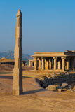 Free Standing Column Temple Hampi Obelisk. A monolithic free standing stone column stands atop a hill among the ancient ruins of Hampi, Karnataka, India royalty free stock image