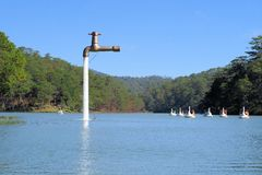 Free standing faucet floating over a lake Royalty Free Stock Photos