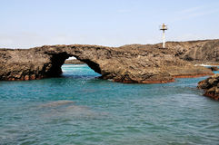 Free standing natural volcanic arch. Of Baia in Salinas with its rugged texture Stock Image