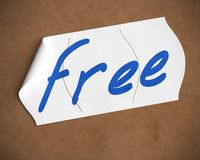 Free sticker over brown carbboard Royalty Free Stock Photography
