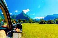 Free summer car travelling road trip in beautiful mountain landscape Stock Images