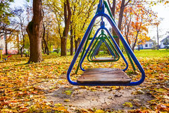 Free swings in sunny autumn Stock Photos