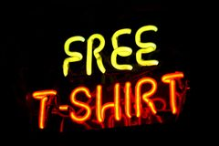 Free T-shirt sign. Free Tshirt - neon sign in yellow and red Royalty Free Stock Photos