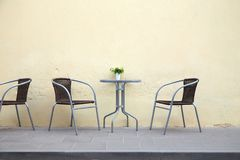 Free table in a street cafe. Empty table in a street cafe in the old town of Vilnius, Lithuania royalty free stock image