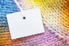 Free Tag on rainbow Christmas gloves texture. stock photos