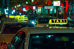 The free taxi on the night street near Potsdamer P Royalty Free Stock Images