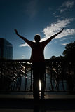 Free teenager embracing the sky. Enjoy freedom with teenager embracing the blue sky Royalty Free Stock Images
