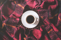 Free time concept. Coffee cup, beans and checkered plaid. Freen time concept Stock Image
