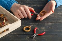 Free time evening making beads. Woman leisure home work hobby stock image