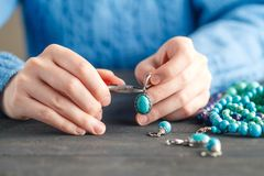 Free time evening making beads. Woman leisure home work hobby royalty free stock photo