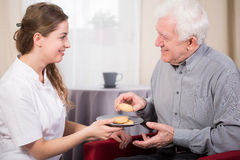 Free time in sanitarium. Pensioner and his nurse during free time in sanitarium royalty free stock photos