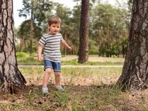 Free time from school. Spare time concept, Positive emotions effect. Boy having fun outdoor. Boy is waiting for the ball from friend. Free time from school royalty free stock photo
