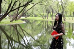 Young woman in green park, book and reading. Happiness, beautiful royalty free stock photos