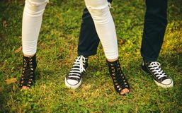 Free to be casual. Female and male legs in modern shoes. Womens and mens shoes. Casual fashion trends. Human legs wear royalty free stock image