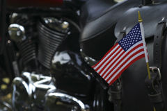 Free to Ride. Conceptual image of a motorcycle decorated with a small American flag - shallow depth of field to emphasize the flag, room for text at left Stock Images