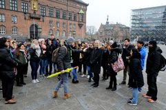 FREE TOUR GETHERING WITH TOURISTS. Copenhagen /Denmark / 2...March.2018_ . Holiday makers waiting with other for Free Tour pay donations only. Photo.Francis royalty free stock photos