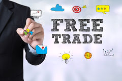 FREE TRADE. Businessman drawing Landing Page on blurred abstract background Stock Image