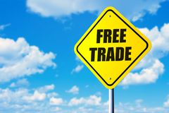 Free trade. Road sign and blue sky Stock Image