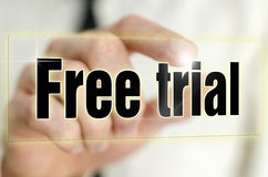 Free trial. Choosing Free trial icon on virtual screen Royalty Free Stock Image