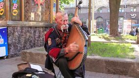 Free Ukrainian Cossack  - bandura player (bandura - ukrainian string instrument) Stock Photo