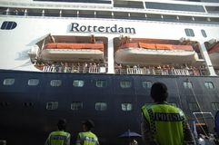 FREE VISA FOR FOREIGN TOURISTS IN INDONESIA 2015. A number of police woman standing besides cruises MS Rotterdam which the netherlands flag who reclines in a Stock Photography