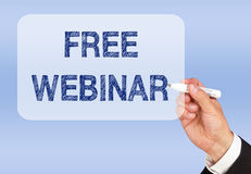 Free webinar. Man holding marker wearing business suit writing free webinar in in message box on blue screen Stock Photography