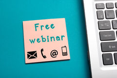 Free webinar. Office table top view - Laptop and reminder with text. Royalty Free Stock Photography