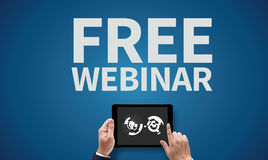 FREE WEBINAR. On the tablet pc screen held by businessman hands - online, top view stock images