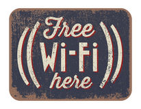 Free Wi-Fi here. Vector illustration of Free Wi-Fi here sign in vintage design Stock Photos