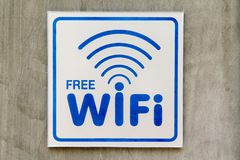 Free WiFi sign on concrete wall.  Royalty Free Stock Photo