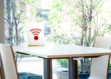 Free wifi sign label for Customer on the table. In the fastfood restaurant Royalty Free Stock Photos