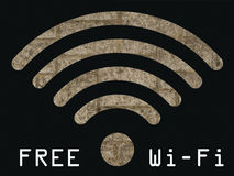 Free WIFI sign. With old stonework wall visible through graphics on black background Royalty Free Stock Photo