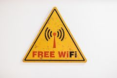 Free Wifi Signage. Free Wifi yellow signage in room royalty free stock images