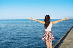 Free woman enjoying the summer with open arms on the beach Royalty Free Stock Images