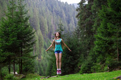 Free woman praising freedom. In the forest Royalty Free Stock Photos