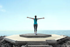 Free woman raising arms to clear blue sky Royalty Free Stock Photo